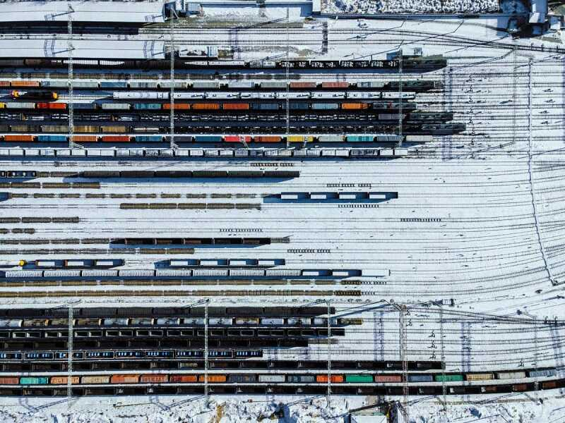 Aerial View of Freight Trains and Railway Station in Winter